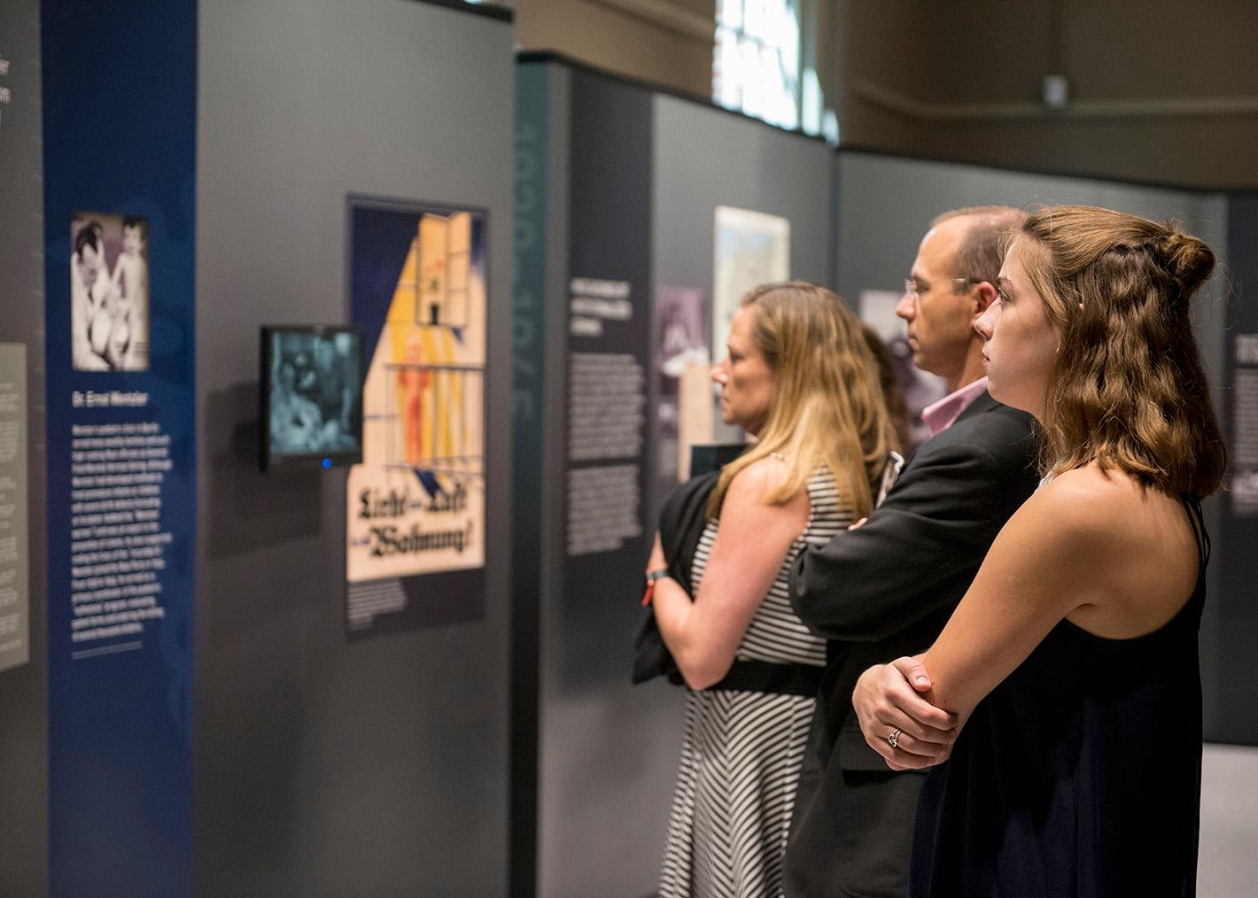 Visitors viewing Deadly Medicine: Creating the Master Race. The exhibition was produced by the USHMM and traveled to the Reece Museum the fall of 2017.