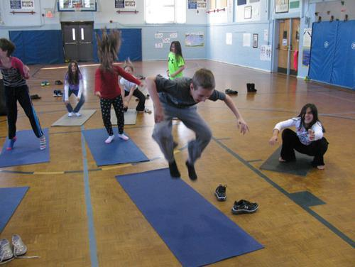 Ms Cradic's Class learning yoga