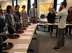 A music MAT student demonstrates drumming techniques during a peer lesson demonstration