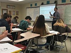 A job-embedded MAT student teaches Spanish to a high school classroom