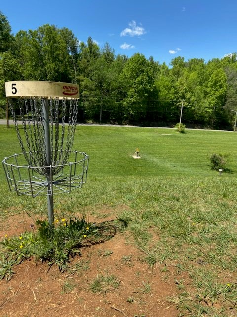 Disc Golf Basket and field